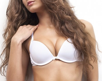 Female With Long Wavy Brown Hair Wearing White Bra